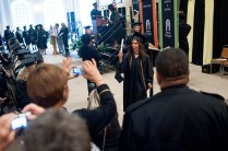 Vanessa Larrick waves her diploma as her mother Martha takes her photograph.