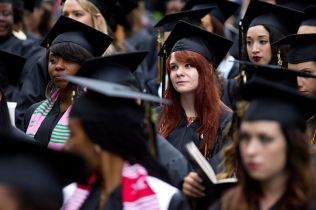 Alicia Bittle listens along as commencement speaker Anne-Marie Slaughter speaks to them on graduation day.