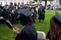 Bonnie Kin approaches the stage after she was awarded the Vulcan Teaching Award during the 2013 Women's College commencement ceremonies.