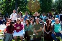 Family and friends of graduates on the front lawn of Brenau University's Gainesville campus.