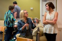 Carly Burruss, left, and Patience Bryant, of the Sawnee Mountain Train Wreck chat during a performance break at the Bluegrass and Books event in the Brenau University Tea Room.
