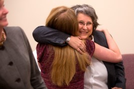 Lee Anne Romberg White gives a hug to Brenau student Emily Burgess during the Women's Leadership Colloquium.