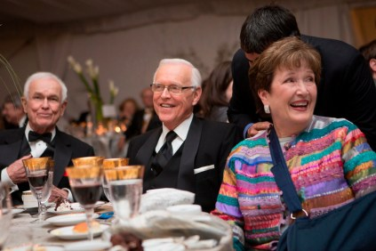 Dr. John S. Burd, center, smiles alongside his wife Pat and former Brenau trustee Tommy Paris during the live auction at the Brenau Gala.