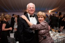 Brenau Trustees Chairman Pete Miller poses for a portrait with his wife Cathy under the tent at the Brenau Gala.