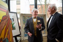 Brenau University President Ed Schrader talks to Brenau Trustees Chairman Peter Miller about the artwork in the silent art auction at the Brenau Gala.