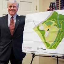 """Brenau President Ed Schrader with the site plan for the new athletics complex, which he calls """"a vital community asset in an area that has only begun to see significant commercial and residential redevelopment."""""""