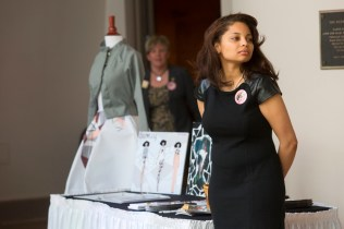 Brenau's Star Beaufait displays some of her fashion design work during the 2015 Women's Leadership Colloquium.