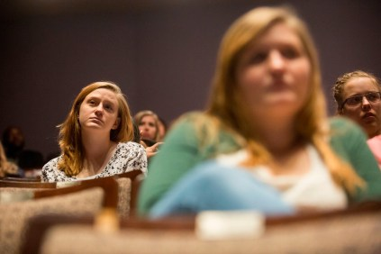 Brenau students listen from the seats in the Hosch Theatre.