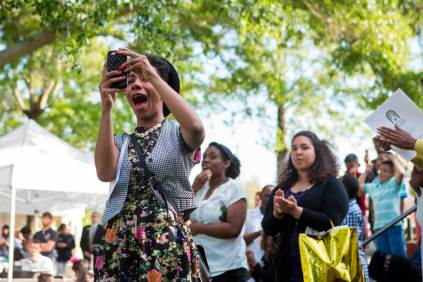 Brenau alumna Pytron Parker cheers as her friend Precious West graduates during this year's Brenau Women's College Commencement.