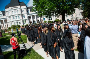 The Brenau Women's College graduating class of 2015 make their way to their seats during this year's commencement.