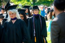 Mengqiu Zhao smiles to the crowd as she walks up to the stage to receive her Master of Interior Design degree during the 2015 Undergraduate and Graduate Commencement at Brenau.