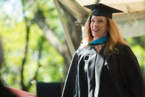 Anne Cahill walks across the stage to earn her Master of Occupational Therapy degree during the 2015 Undergraduate and Graduate Commencement.