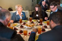 Sandra Deal talks with Rachel Strazynski Shusner, an alumna of Brenau University's Master of Occupational Therapy program, during a lunch where her husband Gov. Nathan Deal signed a bill into law that stemmed from a class project Strazynski worked on.