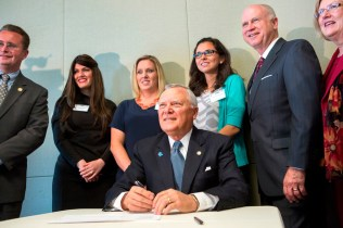 Gov. Nathan Deal signed House Bill 62 into law on Wednesday, April 29, which stemmed from a class project Brenau occupational therapy alumnae Rachel Strazynski Shusner, Shelby Wrenn and Allison Guisasola (back) worked on while they earned their master in Occupational Therapy degrees at Brenau.
