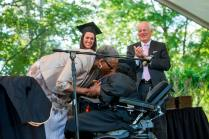 """""""Grandma"""" DeBerne Kelly kisses her granddaughter Byronica Banks after she was awarded an honorary degree during the 2015 Brenau Women's College Commencement."""