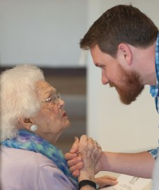 Mary Cleveland speaks with her grandson Scott Cleveland during the celebration to honor the dedication of The Cleveland Physical Therapy Lobby at the Brenau Downtown Center on Friday, July 3, 2015, in Gainesville, Georgia. (AJ Reynolds for Brenau University)