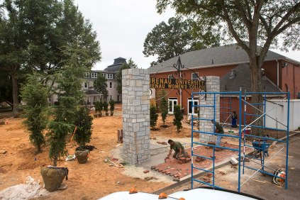 rews from All Outdoor lay pavers beneath the former entry sign to the Brenau Women's College which will now serve as the gateway to a new greenspace on the site of the former Sorority Circle.