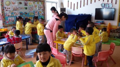 These students at a private kindergarten in Wuhu are working on creative activities in the classroom. In China, children may enter kindergarten as early as 18 months old and attend until they are 5 years old.
