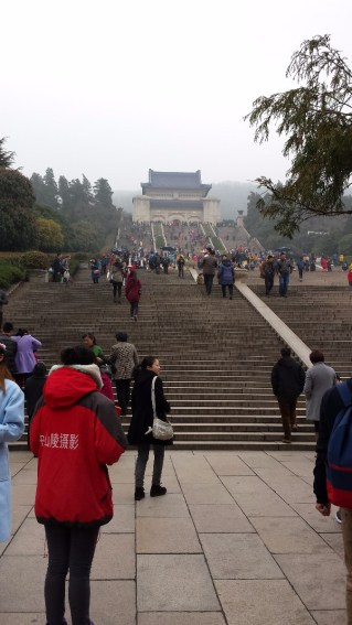 During a weekend trip to Nanjing we had the opportunity to visit the mausoleum of Dr. Sun Yat Sen, who is celebrated as an early revolutionary leader in China. The mausoleum and adjoining park cover many acres of Mount Zinjin (Purple Mountain) just outside the city. Our interpreter Rebecca, a faculty member at Anhui Normal University in the School of Foreign Studies, appears in the foreground carrying a white purse.