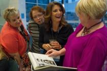 Vanessa Stallings Wood, from left, Katie Dugan, Ilicia Goodman, and Darlene Vinson Bardwell, all WC '91, laugh while looking at a yearbook during the Brenau University Alumnae Reunion Weekend on Friday, April 15, 2016, in Gainesville, Ga. (AJ Reynolds/Brenau University)