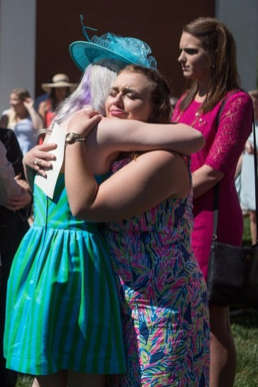 Katherine Fuller, a freshman conflict resolution & legal studies major, hugs Alyson Shields, WC '13, at the dedication of a memorial table for Rae Marie Brewer during the Brenau University Alumnae Reunion Weekend on Saturday, April 16, 2016, in Gainesville, Ga. (AJ Reynolds/Brenau University)