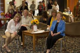 """Clara Martin, right, laughs with her daughters Dorothy """"Dottie"""" Martin Corey, WC '78, from right, Elizabeth Martin Carpenter, WC '80, and Mary Helen Martin, WC '84, during a celebration in her honor during the Brenau University Alumnae Reunion Weekend on Saturday, April 16, 2016, in Gainesville, Ga. (AJ Reynolds/Brenau University)"""