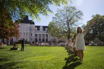 Allie Smith, a mass communications major, leads the juniors as they carry the daisy chain to the crows nest during the Brenau University Alumnae Reunion Weekend on Saturday, April 16, 2016, in Gainesville, Ga. (AJ Reynolds/Brenau University)