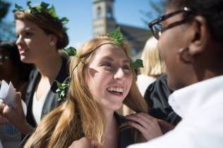 Emily Burgess, an organizational leadership major, center, smiles after being crowned by Dana Cole, a biology major, during the Brenau University Alumnae Reunion Weekend on Saturday, April 16, 2016, in Gainesville, Ga. (AJ Reynolds/Brenau University)