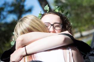 Stephanie Daniell, a senior biology major, gives a hug atop the crow's nest during the Brenau University Alumnae Reunion Weekend on Saturday, April 16, 2016, in Gainesville, Ga. (AJ Reynolds/Brenau University)