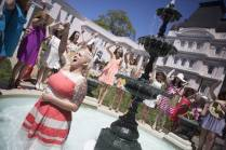 Kegan Guttry, WC '13, leads a chant in the Grace Hooten Moore Memorial Fountain and is serenaded by her sorority sisters during the Brenau University Alumnae Reunion Weekend on Saturday, April 16, 2016, in Gainesville, Ga. (AJ Reynolds/Brenau University)