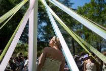 May Queen MK Jabbia looks up after members of the May Court wrapped the maypole during the Brenau University Alumnae Reunion Weekend on Saturday, April 16, 2016, in Gainesville, Ga. (AJ Reynolds/Brenau University)