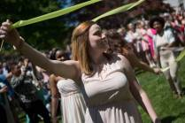 May Court member Chelsey Holland, a sophomore early childhood education major, wraps the maypole during the Brenau University Alumnae Reunion Weekend on Saturday, April 16, 2016, in Gainesville, Ga. (AJ Reynolds/Brenau University)