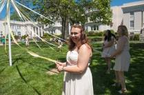 Katherine Nell Fuller, '19, stands as the May Court gets ready to wrap the May Pole. 2016 Alumnae Reunion Weekend