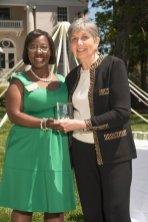 Marsha Stringer, WC '96, BU '03, '05 awards Melda Bassett, WC '74 the Alumni Hall of Fame award. 2016 Alumnae Reunion Weekend