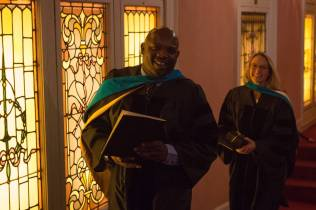 Dr. Allen Patmon and Dr. Sara Propes, both Occupational Therapy Doctorates, make their way outside after the Brenau University College of Health Sciences Graduate Hooding Ceremony on Thursday, May 5, 2016. (AJ Reynolds/Brenau University)