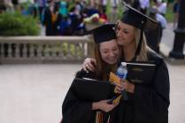 Emily Lemons, left, and Brittany Daniel, both WC '16, hug after The Women's College Commencement on Friday, May 6, 2016, in Gainesville, Ga. (AJ Reynolds/Brenau University)