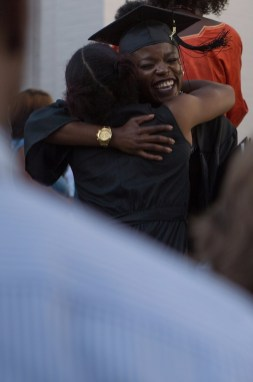 Olamide Sokunbi, WC '16, gets a hug after The Women's College commencement on Friday, May 6, 2016, in Gainesville, Ga. (AJ Reynolds/Brenau University)
