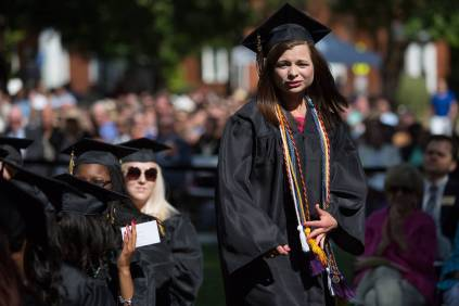 Hannah Doster, WC '16, walks to the stage as a co-winner of the Cora Anderson Hill Academic Award during The Women's College commencement on Friday, May 6, 2016, in Gainesville, Ga. (AJ Reynolds/Brenau University)