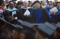 Kay Graham walks to the stage to accept the Ann Austin Johnson Outstanding Faculty Award during The Women's College commencement on Friday, May 6, 2016, in Gainesville, Ga. (AJ Reynolds/Brenau University)