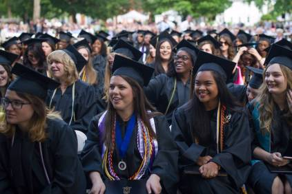Graduates smile and laugh during The Women's College commencement on Friday, May 6, 2016, in Gainesville, Ga. (AJ Reynolds/Brenau University)