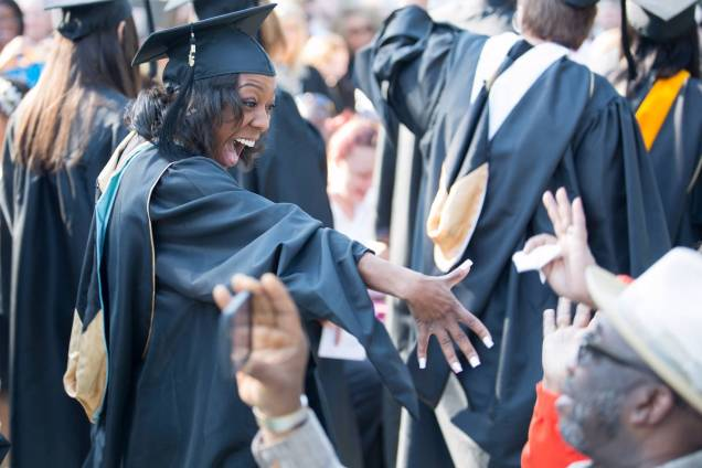 Winter Cardwell, who received a Master of Arts in Teaching degree, greets family and friends while during the processional during the Brenau University Undergraduate and Graduate Commencement on Saturday, May 7, 2016, in Gainesville, Ga. (AJ Reynolds/Brenau University)