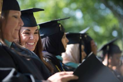 Jennifer Ryan Ray smiles while speaking with Turrah Benton, both candidates for the Educational Specialist Degree, during the Brenau University Undergraduate and Graduate Commencement on Saturday, May 7, 2016, in Gainesville, Ga. (AJ Reynolds/Brenau University)