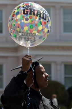Mitchell Smith, BU '16, carries a congratulatory balloon after receiving an undergraduate degree and majoring in health sciences at the Brenau University Undergraduate and Graduate Commencement on Saturday, May 7, 2016, in Gainesville, Ga. (AJ Reynolds/Brenau University)