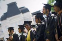 Denise Fields, from right, Jared Kauffman, Ramadan Kelly Romona Armstead and Jasmine Crooks, all BU '16, stand for the singing of the alma mater during the Brenau University Undergraduate and Graduate Commencement on Saturday, May 7, 2016, in Gainesville, Ga. (AJ Reynolds/Brenau University)