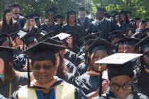 Candidates stand to be conferred their bachelors degrees during the Brenau University Undergraduate and Graduate Commencement on Saturday, May 7, 2016, in Gainesville, Ga. (AJ Reynolds/Brenau University)