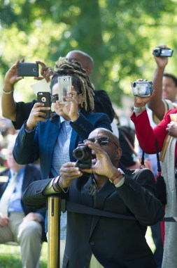 Family and friends take photos during the Brenau University Undergraduate and Graduate Commencement on Saturday, May 7, 2016, in Gainesville, Ga. (AJ Reynolds/Brenau University)