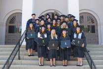 Graduates with masters degrees in psychology pose for a photo after the Brenau University Undergraduate and Graduate Commencement. (AJ Reynolds/Brenau University)