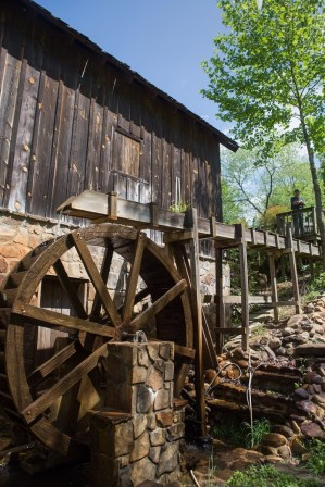 The village at Lott farm, which includes an old mill, began after the couple moved an 1800s cabin from Lake Burton to their property in Cleveland, Georgia. (AJ Reynolds/Brenau University)