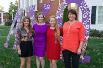 Mary Kathryn Wells, WC '00, Kristen Soltis Anderson, a Republican pollster and strategist, Alpha Chi Omega President Emily Burgess and Brenau Trustee Anna Jacobs, WC '86, pose for a photo in front of their sorority letters before Beyond the Talking Points: What Election 2016 Really Means to Women. The discussion was a part of the Douglas and Kay Ivester Programming Series at the university. (AJ Reynolds/Brenau University)