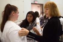Diana Eden, right, helps Sarah Morales take measurements during The Art of Costume Design workshop presented by Diana Eden. (AJ Reynolds/Brenau University)